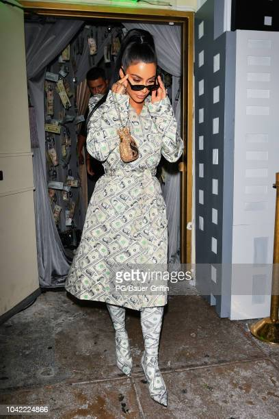Kim Kardashian is seen wearing a money dress and matching boots on September 27 2018 in Los Angeles California