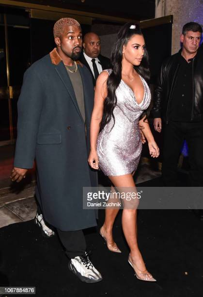 Kim Kardashian is seen wearing a Versace dress with Kanye West outside the Versace PreFall 2019 Collection on December 2 2018 in New York City