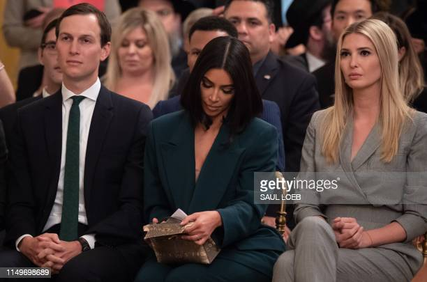 Kim Kardashian, Ivanka Trump and Jared Kushner listen as US President Donald Trump speaks about second chance hiring and criminal justice reform in...