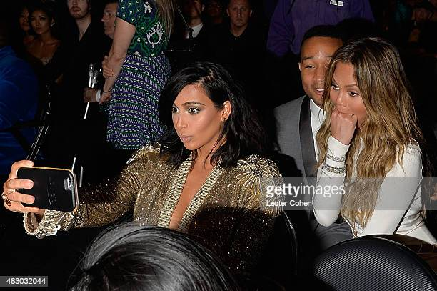 Kim Kardashian John Legend and Chrissy Teigen take a selfie during The 57th Annual GRAMMY Awards at the STAPLES Center on February 8 2015 in Los...