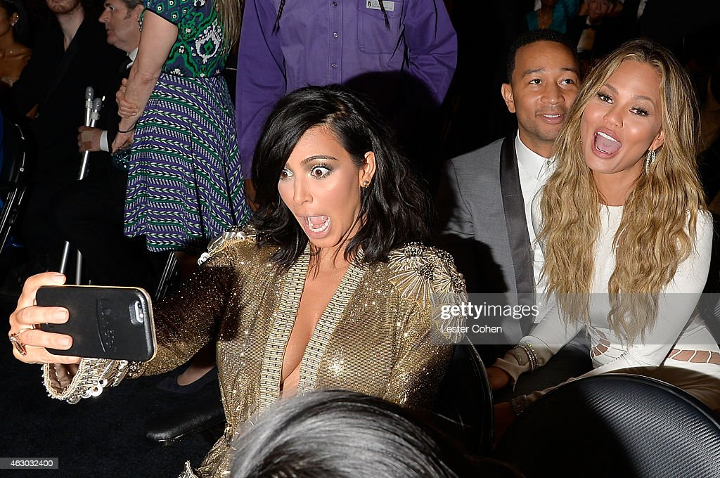 Kim Kardashian, John Legend and Chrissy Teigen take a selfie during The 57th Annual GRAMMY Awards at the STAPLES Center on February 8, 2015 in Los Angeles, California.