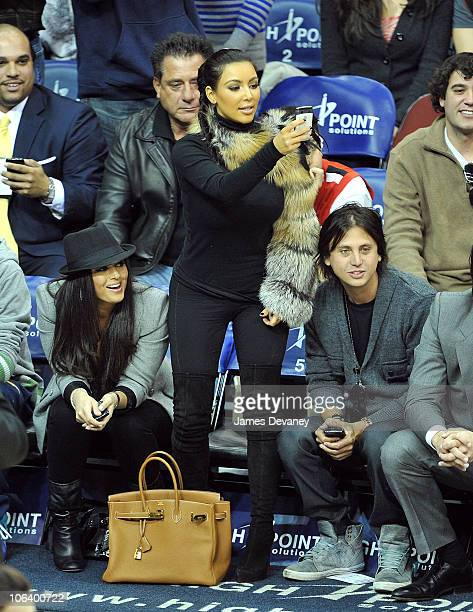 Kim Kardashian Jonathan Cheban and guest attend the Miami Heat vs NJ Nets Game at Prudential Center on October 31 2010 in Newark City