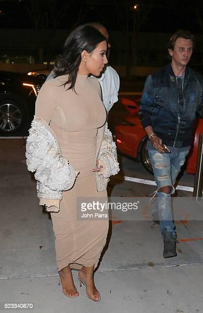 Kim Kardashian Kanye West and Jonathan Cheban arrive at Komodo restaurant to celebrate nightclub owner David Grutman's wedding on April 22 2016 in...