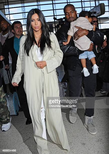 Kim Kardashian Kanye West and North West are seen at LAX on April 07 2015 in Los Angeles California
