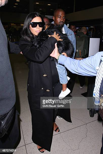 Kim Kardashian Kanye West and North West are seen at LAX on September 05 2015 in Los Angeles California