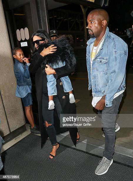 Kim Kardashian Kanye West and North West are seen on September 05 2015 in Los Angeles California
