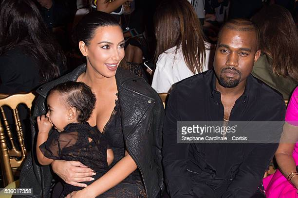 Kim Kardashian Kanye West and their daughter North West attend the Givenchy show as part of the Paris Fashion Week Womenswear Spring/Summer 2015 on...