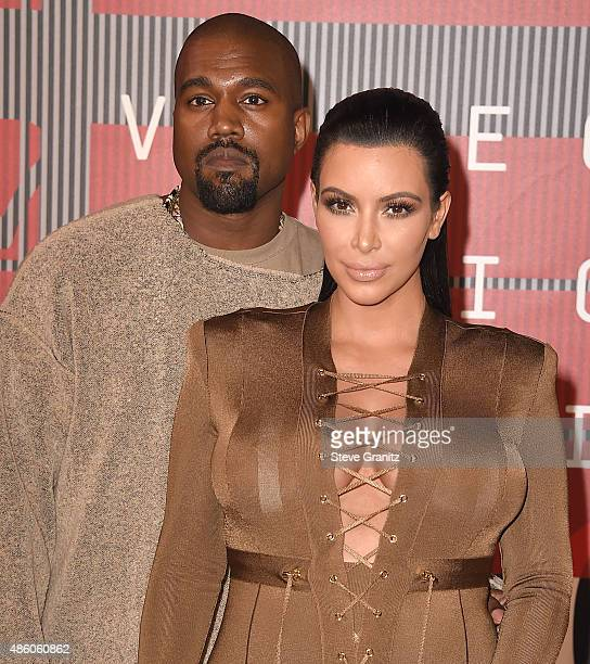 Kim Kardashian Kanye West arrives at the 2015 MTV Video Music Awards at Microsoft Theater on August 30 2015 in Los Angeles California