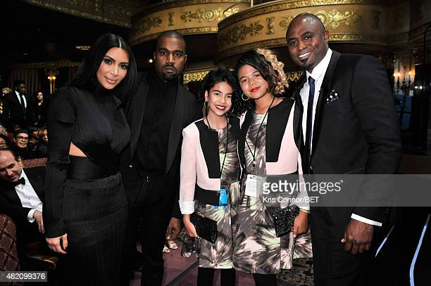 Kim Kardashian Kanye West guest Maile Masako Brady and Wayne Brady attend The BET Honors 2015 at Warner Theatre on January 24 2015 in Washington DC
