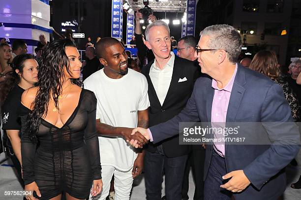 Kim Kardashian Kanye West pose with President of MTV Sean Atkins and President of Viacom Music and Entertainment Doug Herzog at the 2016 MTV Video...