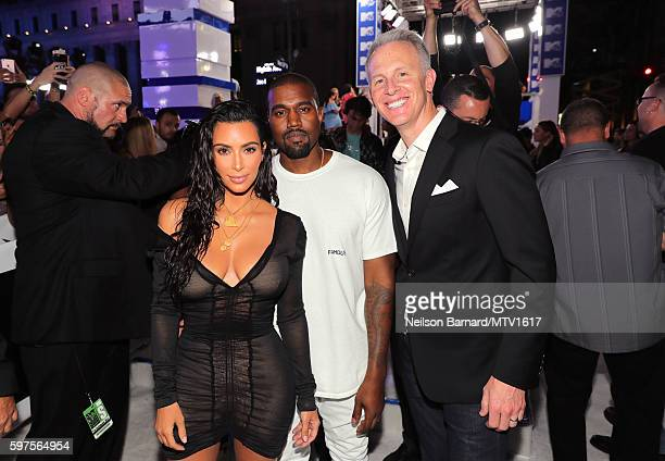 Kim Kardashian Kanye West pose with President of MTV Sean Atkins at the 2016 MTV Video Music Awards at Madison Square Garden on August 28 2016 in New...