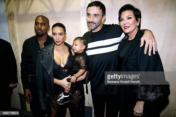 Kim Kardashian Kanye West their daughter North West Mother of Kim Kardashian Kris Jenner and Fashion designer Riccardo Tisci pose backstage after the...