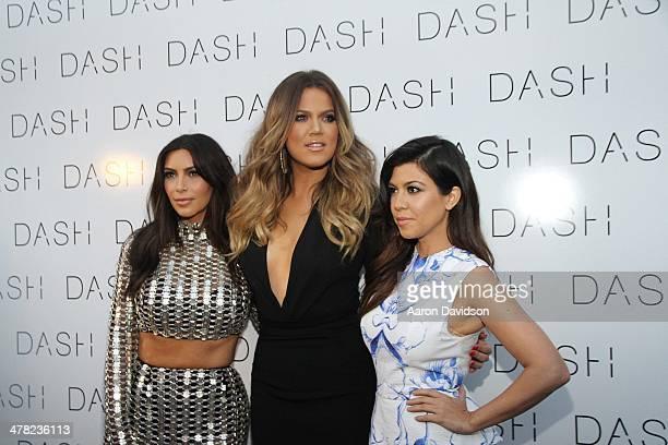 Kim Kardashian, Khloe Kardashian and Kourtney Kardashian attends the grand opening of DASH Miami Beach at Dash Miami Beach on March 12, 2014 in Miami...