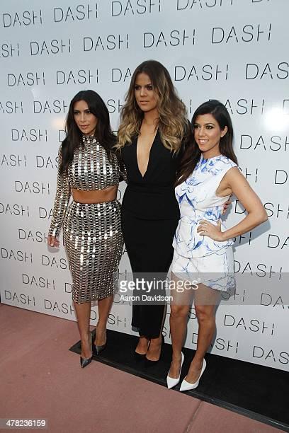 Kim Kardashian Khloe Kardashian and Kourtney Kardashian attends the grand opening of DASH Miami Beach at Dash Miami Beach on March 12 2014 in Miami...