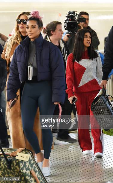 Kim Kardashian Kourtney Kardashian and Khloe Kardashian are seen upon arrival at Tokyo Station on March 2 2018 in Tokyo Japan