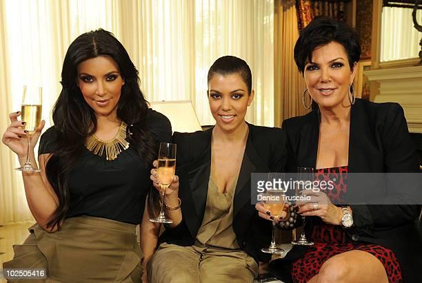 """Kim Kardashian, Kourtney Kardashian and Kris Kardashian toast to the announcement of the """"Kardashian Khaos"""" store opening at the Mirage Hotel and..."""
