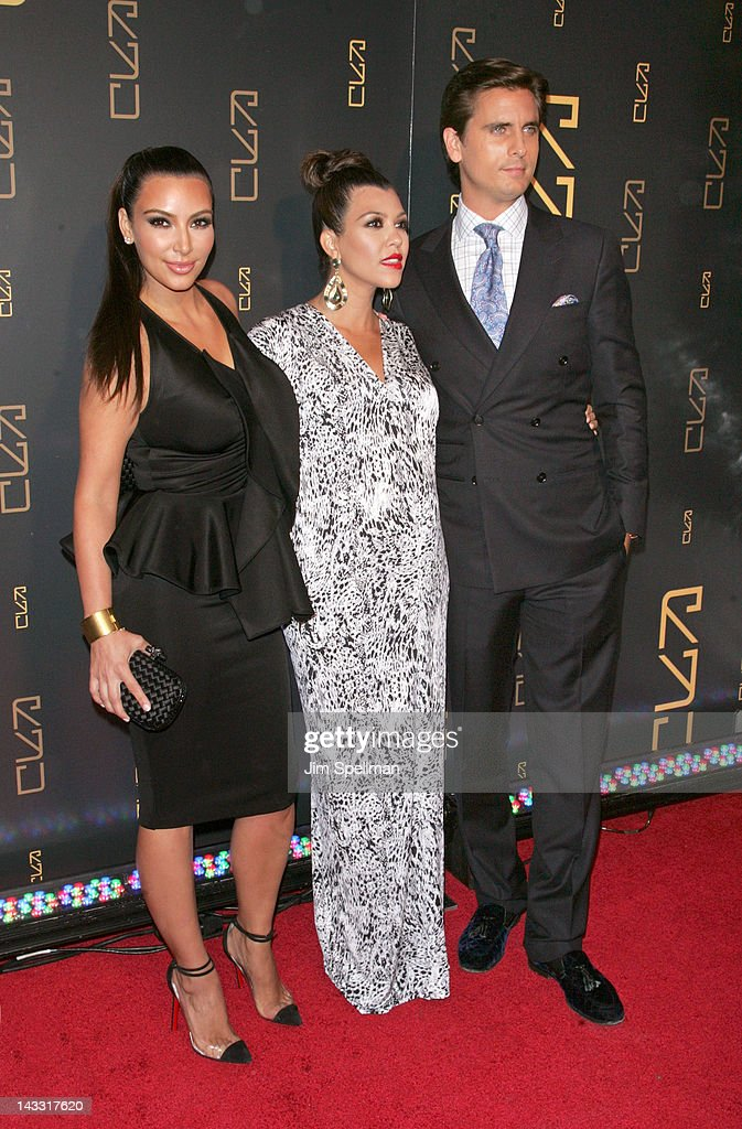 Kim Kardashian, Kourtney Kardashian and Scott Disick attend the grand opening of RYU on April 23, 2012 in New York City.