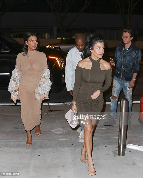 Kim Kardashian Kourtney Kardashian Kanye West and Jonathan Cheban arrive at Komodo restaurant to celebrate nightclub owner David Grutman's wedding on...