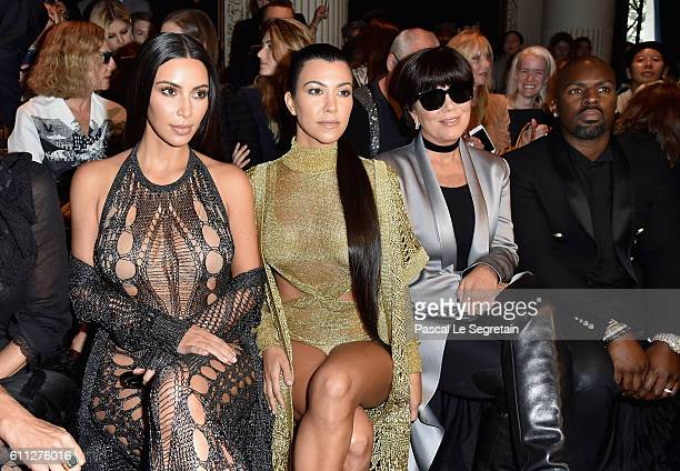 Kim Kardashian Kourtney Kardashian Kris Jenner and Corey Gamble attend the Balmain show as part of the Paris Fashion Week Womenswear Spring/Summer...