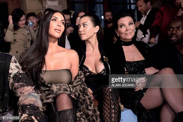 Kim Kardashian Kourtney Kardashian Kris Jenner and Corey Gamble attend the Offwhite 2017 Spring/Summer readytowear collection fashion show on...