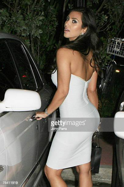 Kim Kardashian Leaving Shay Todd Show posing for photographers on a Mercedes-Benz and Bentley out side the Raleigh Hotel on July 13, 2007 in Miami...