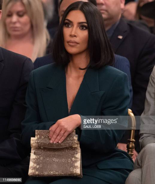 Kim Kardashian listens as US President Donald Trump speaks about second chance hiring and criminal justice reform in the East Room of the White House...