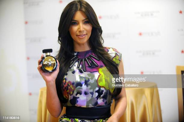 Kim Kardashian meets and greets fans at the launch of her perfume at Macys on May 14 2011 in Aventura Florida