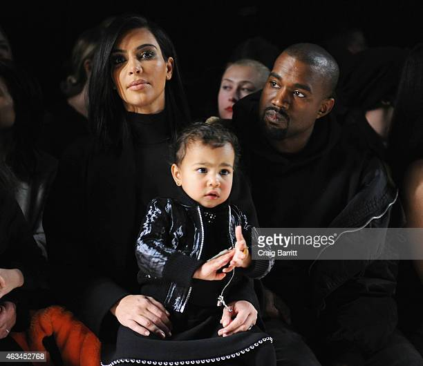 Kim Kardashian, North West and Kanye West attend the Alexander Wang Fashion Show during Mercedes-Benz Fashion Week Fall 2015 at Pier 94 on February...