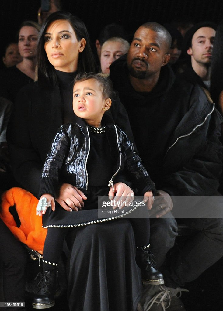 Kim Kardashian, North West and Kanye West attend the Alexander Wang Fashion Show during Mercedes-Benz Fashion Week Fall 2015 at Pier 94 on February 14, 2015 in New York City.