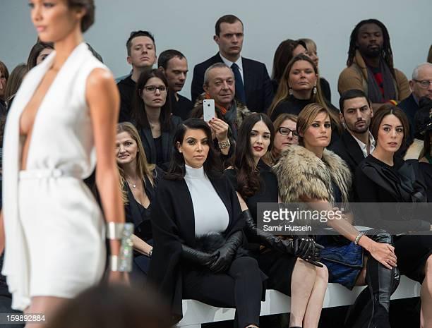 Kim Kardashian, Paz Vega, Yasmin Le Bon and Sophia Assaidi watch a model walk the catwalk during the Stephane Rolland Spring/Summer 2013...