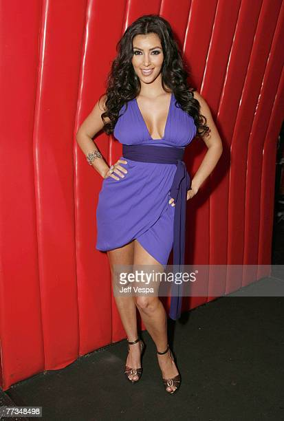 Kim Kardashian poses for a photo at the Keeping Up With the Kardashians viewing party at Chapter 8 Restaurant on October 16 2007 in Agoura Hills...
