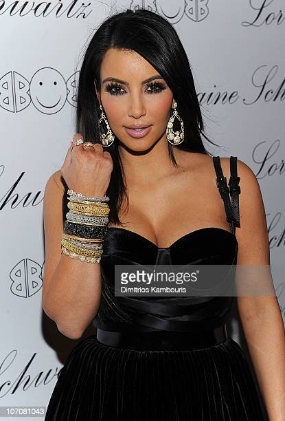 "Kim Kardashian poses with Lorraine Schwartz ""2BHAPPY"" Jewelry Collection at the launch at Lavo on November 22, 2010 in New York, New York."