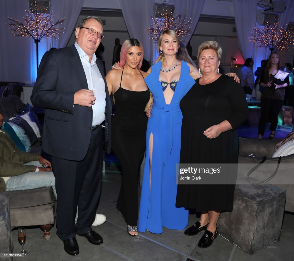 Kim Kardashian poses with Marina Acton and her parents at The Release Of Marina Acton's New Single 'Fantasize' at Boulevard3 on March 5, 2018 in Hollywood, California.