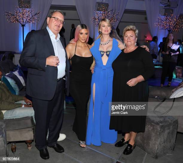 Kim Kardashian poses with Marina Acton and her parents at The Release Of Marina Acton's New Single Fantasize at Boulevard3 on March 5 2018 in...