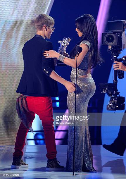 Kim Kardashian presents award to Justin Bieber on stage at the The 28th Annual MTV Video Music Awards at Nokia Theatre LA LIVE on August 28 2011 in...