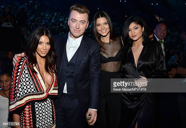 Kim Kardashian Sam Smith Kendall Jenner and Kylie Jenner during the 2014 MTV Video Music Awards at The Forum on August 24 2014 in Inglewood California