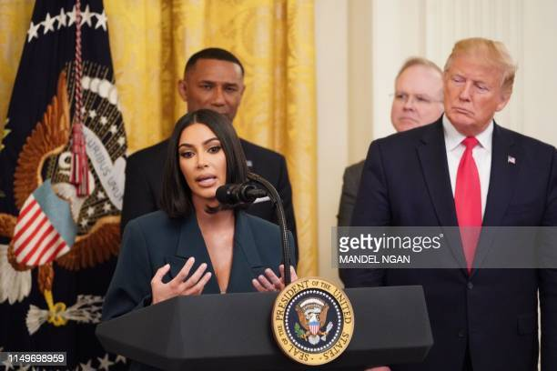 Kim Kardashian speaks as US President Donald Trump holds an event on second chance hiring and criminal justice reform in the East Room of the White...
