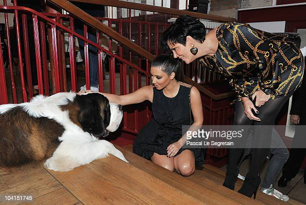ACCESS*** Kim Kardashian strokes a dog as Kris Jenner stands at the Azzedine Alaia boutique on September 16 2010 in Paris France