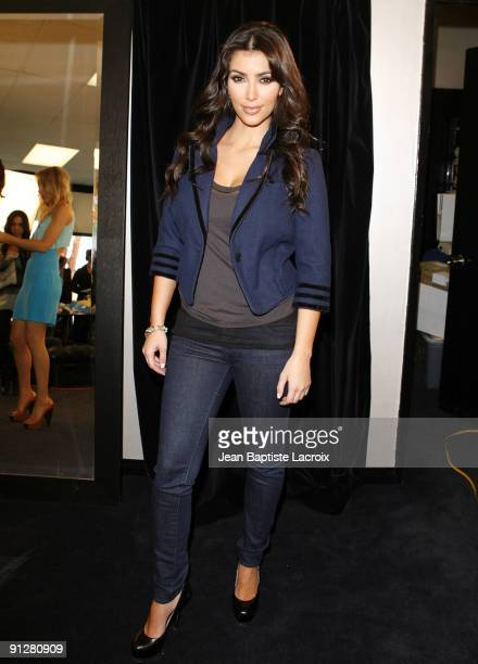 CALABASAS CA FEBRUARY 06 *EXCLUSIVE* Kim Kardashian tries on Shopflickcom treads at Dash Boutique on February 6 2009 in Calabasas California