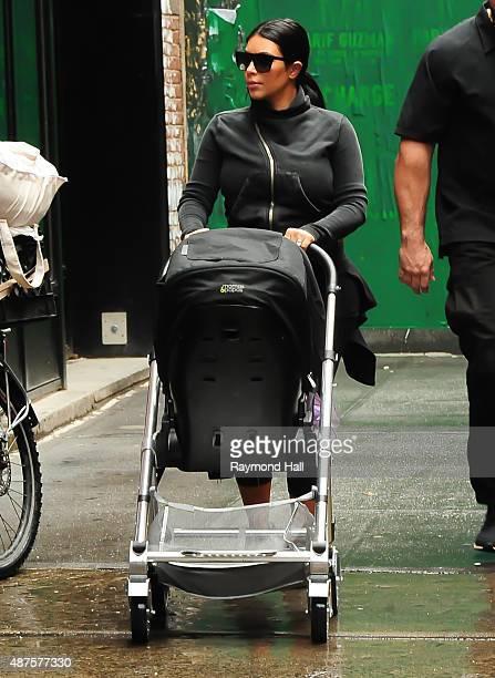 Kim Kardashian walks Baby North West to Soho Gym on September 10 2015 in New York City