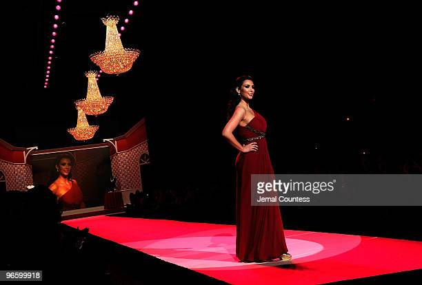 Kim Kardashian walks the runway at the Heart Truth Fall 2010 Fashion Show during MercedesBenz Fashion Week at The Tent at Bryant Park on February 11...