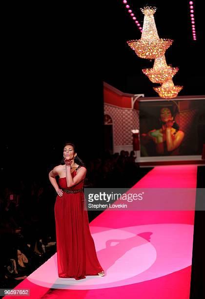 Kim Kardashian walks the runway during Swarovski at the Red Dress Collection 2010 Fashion Show during MercedesBenz Fashion Week at The Tent at Bryant...