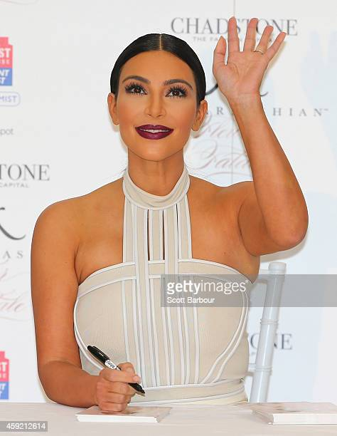 Kim Kardashian waves as she promotes her new fragrance Fleur Fatale at Chadstone Shopping Centre on November 19 2014 in Melbourne Australia