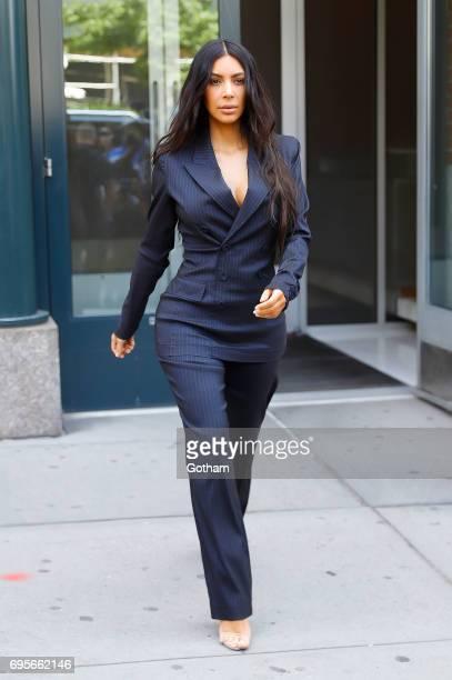 Kim Kardashian wears a blue pinstripe powersuit to attend the Forbes Women'sSummit on June 13 2017 in New York City