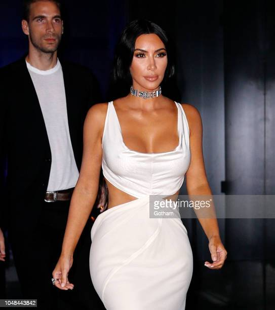 Kim Kardashian wears a open back dress on October 9 2018 in New York City