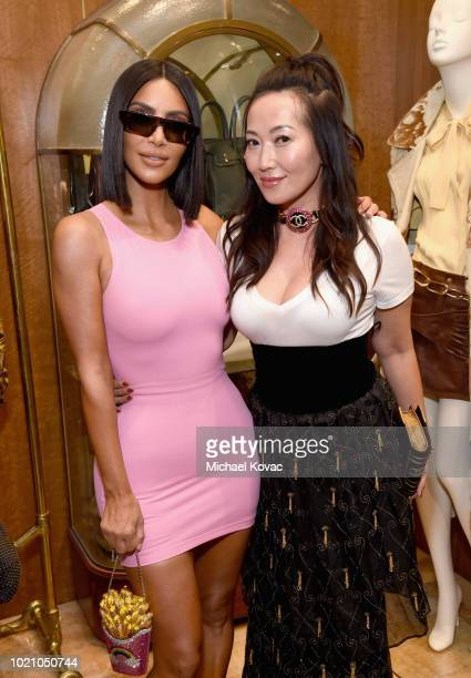 Kim Kardashian West and Bag Snob Cofounder Tina Craig attend Christie's x What Goes Around Comes Around 25th Anniversary Auction Preview at What Goes...