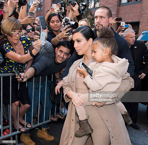 Kim Kardashian West and her daughter North West are seen arriving at Kanye West Yeezy Season 2 during Spring 2016 New York Fashion Week at Skylight...