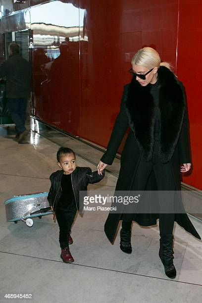 Kim Kardashian West and her daughter North West are seen at 'CharlesdeGaulle' airport on March 12 2015 in Paris France