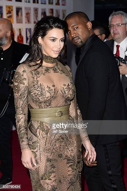 Kim Kardashian West and Kanye West arrive for the Gala to celebrate the Vogue 100 Festival at Kensington Gardens on May 23 2016 in London England