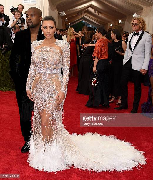 Kim Kardashian West and Kanye West attend the China Through The Looking Glass Costume Institute Benefit Gala at the Metropolitan Museum of Art on May...